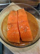 Salmon Fillets Marinating in Maple Syrup Mixture